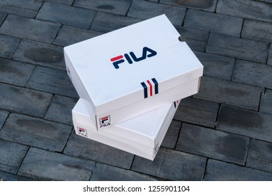 NAKHON PATHOM, THAILAND-NOVEMBER 17, 2018:Box Fila shoe, model disruptor 2 and disruptor 2 point, Fila is one of the world's largest sportswear manufacturing companies., shot outdoor on brick floor