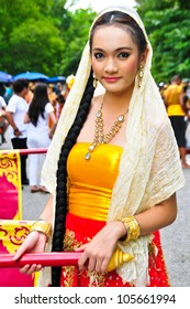 NAKHON PATHOM,THAILAND - JUNE 4: Unidentified Thai girls in traditional dress in Visakha Bucha day to show respect and faith,4 June 2012 at Nakhon Pathom,Thailand.