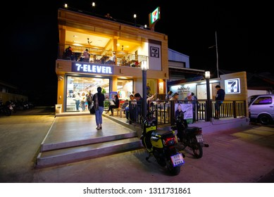 Nakhon Phanom Province, Thailand-December 28 2018. Beautiful exterior design of 7-Eleven (7-11) shop with people in the night. 7-Eleven shop in Thailand owner by CPALL Public Company Limited.