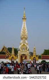 NAKHON PHANOM, THAILAND - 19 February 2019: Buddhists worship Buddha statue during  Phra That Phanom Festival