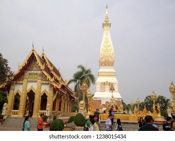 NAKHON PHANOM - THAILAND - APRIL 4, 2016 : A day at Buddhist temple Wat Phra That Phanom with tourists.