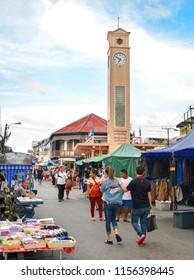 Nakhon Phanom, Thailand - Aug 11, 2018:  Nakhon Phanom Walking  Street market in front of Clock Tower, historical landmark of Nakhon Phanom Province built by Vietnamese people in 1960, on Thailand.