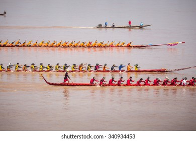 NAKHON PHANOM  THAILAND OCT 25 2015: Unidentified action rowers in Climbing Bows toward Snatching a Flag native Thai long boats compete during Native Long Boat Race Championship on OCT 25, 2015