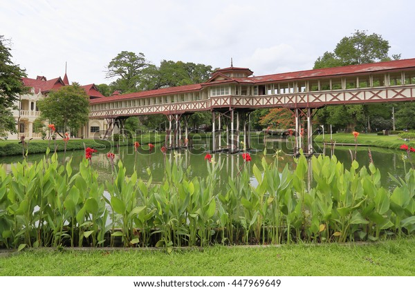 NAKHON PHATHOM//THAILAND - JULY 3: Wooden Pathway connection over pond in Sanam Chandra Palace built by King Vajiravudh (Rama IV), July 3, 2016  in Nakhon Pathom, Thailand