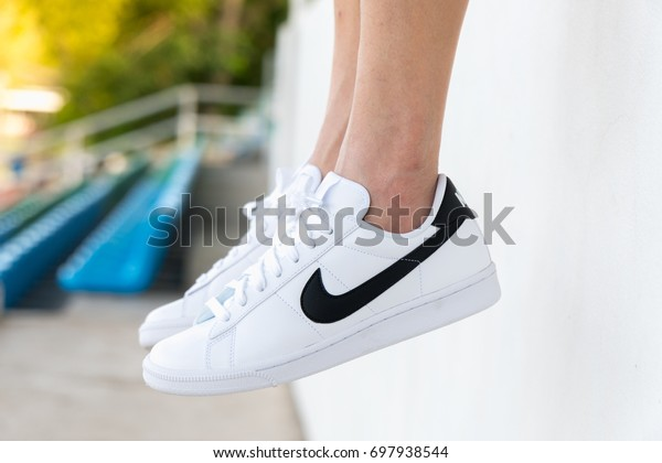 NAKHON PRATHOM, THAILAND - AUGUST 12, 2017:The woman wearing Nike tennis classic white/black shoes ,Nike, Inc. is an American multinational corporation that designs, develops, manufactures and sells tennis shoes.