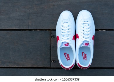 NAKHON PRATHOM, THAILAND - DECEMBER 30, 2017:Nike classic cortez leather white/varsity red - blance/varsity rouge  ,Nike, Inc. is an American multinational corporation that designs, develops