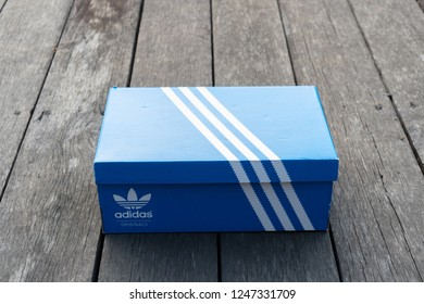 NAKHON PRATHOM, THAILAND-NOVEMBER 17, 2018:Adidas Sign On Adidas Shoe Box. Founded in 1924 is a German multinational corporation that designs and manufactures sports shoes, clothing and accessories.