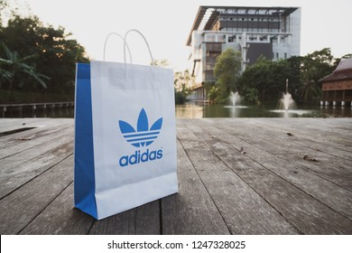 NAKHON PRATHOM, THAILAND-NOVEMBER 17, 2018:Paper bag Adidas original logo for product Adidas original. Adidas - German industrial group specializing in the production of athletic footwear, apparel.