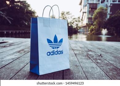 NAKHON PRATHOM, THAILAND-NOVEMBER 17, 2018:Paper bag Adidas original logo for product Adidas original. Adidas - German industrial group specializing in the production of athletic footwear, apparel.