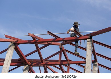 NAKHON RATCHASIMA -JAN 15 : worker installing structure of roof steel for new house at construction site on January 15, 2016 in Nakhon Ratchasima, Thailand