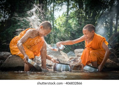Nakhon Ratchasima, Pakchong/Thailand- April 10, 2016: Buddhism, Buddhist novices are cleaning bowls and splashing water in the summer at the creek. (Songkran Festival), Thailand.