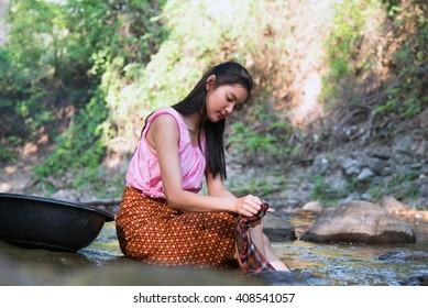 Nakhon Ratchasima, Pakchong/Thailand- April 10, 2016: Thai women washing clothes along the river, Thailand