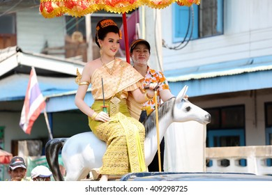 NAKHON RATCHASIMA, THAILAND - APRIL 13: An unidentified woman in Thai uniform sits down on a horse in Songkran festival parade on April 13, 2016, in Si Khio, Nakhon Ratchasima, Thailand