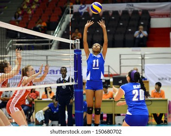 Nakhon Ratchasima, Thailand - AUG 1:Wilmarie Rivera #11 of Puerto Rico in action during FIVB Volleyball Girls U18 World Championship at Chatchai Hall on August 1, 2013 in Nakhon Ratchasima, Thailand.