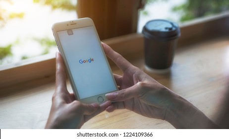Nakhon Ratchasima Thailand. May 16 2018; A woman is typing on Google search engine from a Iphone. Google search with the new Google logo is the biggest Internet search engine in the world.