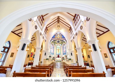 Nakhon Ratchasima, Thailand - November 10, 2018: View of the Main Hall of the Blessed Nicholas Bunkerd Kitbamrung Church Through the Archways in Khao Yai