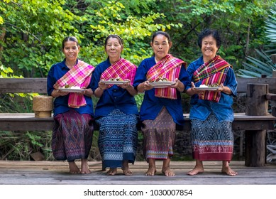 Nakhon Ratchasima, Thailand - October 31, 2015 : Thailand native women dressed in food offerings of old traditional merits at Nakhon Ratchasima province, Thailand