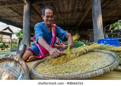 NAKHON RATCHASIMA, THAILAND - OCTOBER 31: Undefined senior villager Making shredded rice grain which is traditional thai food at Beneath of the house on October 31,2015 in Nakhon ratchasima, Thailand.