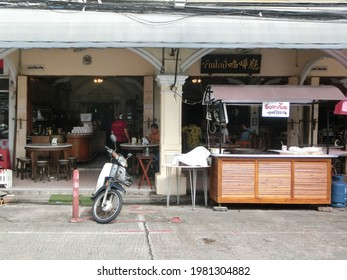 NAKHON SI THAMMARAT, THAILAND - 27 NOVEMBER 2020: Kopi, a local and traditional cafe shop in Nakhon Si Thammarat, is always popular place for coffee, drinks and foods. Kopi cafe signage to welcome.