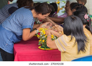NAKHON SI THAMMARAT, THAILAND - APRIL 15: Unidentified Thai people celebrate Songkran by giving garlands to their seniors and asked for blessings on April 15, 2015 in Nakhon Si Thammarat, Thailand.