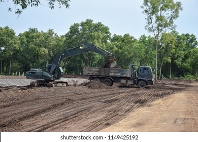 Nakhon Si Thammarat, THAILAND - July 15, 2018: Military Excavator and Truck from 401st Engineer Battalion, 4th Development Division, Fourth Army, RTA. support NST Rajabhat University Construct Campus.