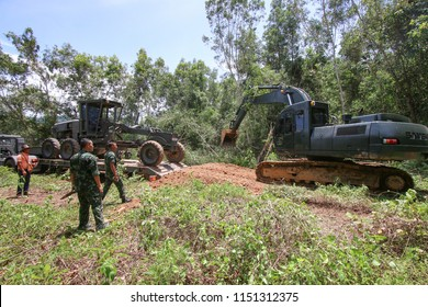 Nakhon Si Thammarat, THAILAND - June 6, 2018: Military Vehicles from Engineer Battalion, Royal Thai Army Support NST Rajabhat University construct dirt road and prepare area for construction campus.