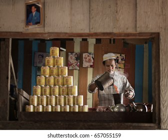 Nakhon Si Thammarat, Thailand - May 1, 2016: A Muslim man in the kitchen pouring tea.