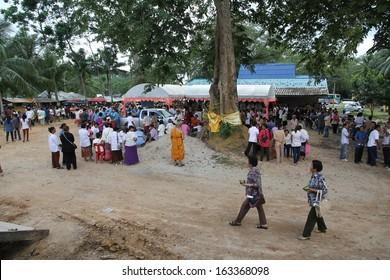 NAKHON SI THAMMARAT, THAILAND, NOVEMBER 2: A traditional Buddhist ceremony, Kathin, held at Wat Khao Phra Thong, Nakhon Si Thammarat, Thailand on the 2nd November, 2013.
