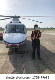 Nakhon Sri thammarat airport,Thailand- May 22,2020-offshore transport helicopter pilot during covid 19 operation pilot wearing  protective coronavirus starting in 2019 or Covid-19.