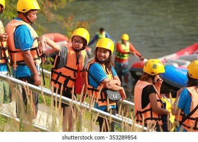 NAKHONNAYOK, THAILAND,DECEMBER 19 : Group of adventurer doing white water rafting at dam, on December 19, 2015,The river is popular for its scenic nature view.