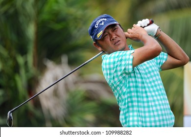 NAKHONPATHOM,THAILA ND - AUG 10:Danny Chia of MAL watches the ball after hits a shot during day two of the Golf Thailand Open at Suwan Golf&Country Club on August 10, 2012 in Nakhonpathom Thailand
