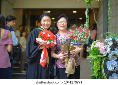 Nakhonpathom,Thailand, December 2, 2017 : Beautiful asian woman student smile happy with mom family proud in her daughter graduation during successful graduate commencement education of university.