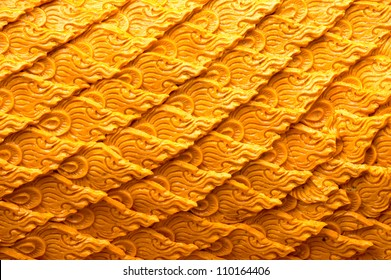 NAKHONRATCHASIMA, THAILAND - AUGUST 5: Candle wax carving Thai style texture in the traditional parade active festival Buddhist Lent on August 5, 2012 in Nakhon Ratchasima, Thailand.