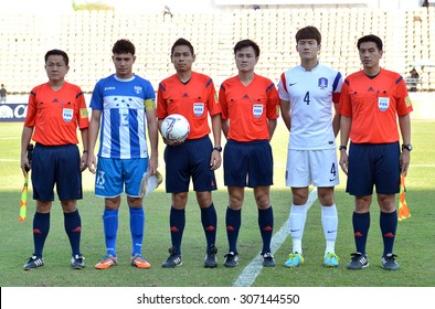 NAKHONRATCHASIMA THAILAND - FEB4: Captain-team of the both team and FIFA referee poses during the 43 King's Cup Friendly Match 2015 on February 4, 2015 in Thailand.
