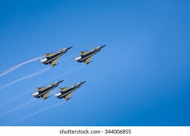 "Nakhonratchasima, THAILAND November 26, 2015 : F16 Gripen and August 1st Aerobatic team"" engaged in acrobatics."