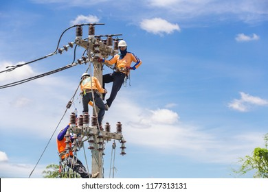 NAKHONRATCHASIMA, THAILAND - SEPTEMBER 1, 2018:Asian men engineering working on high voltage workfield at countryside