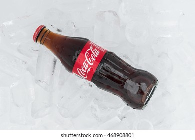 Nakhonratchasima,THAILAND August 14:Coca cola bottle in foam box with ice on white background.on 14 August 2016 in Nakhonratchasima,Thailand