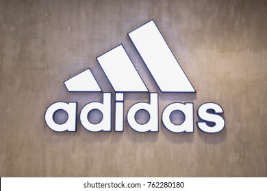 Nakhonratchasrima,Thailand, Nov 24, 2017: Adidas logo at a store. Adidas AG is a German multinational corporation that designs and manufactures shoes, clothing and accessories.