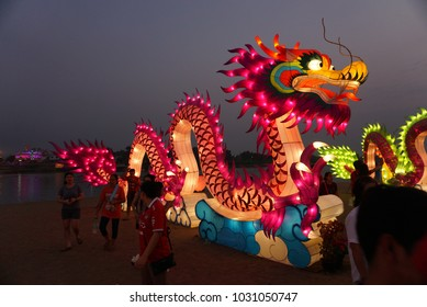 NAKHONSAWAN , THAILAND - February  17, 2018: Unidentified people see Light up green dragon at Nakhonsawan Province to celebrate Chinese New year.