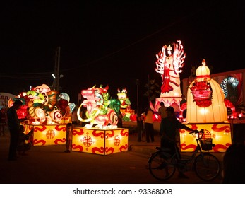 NAKHONSAWAN,NORTHERN/ THAILAND- JANUARY 19: Thousand hands Guan Yin Goddess model lantern and nine dragon's sons models in Chinese New Year Festival on January 19, 2012 in Nakhonsawan.