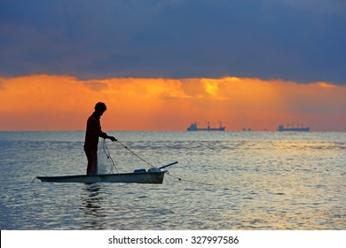 NAKHONSITHAMMARAT, THAILAND - MAR 1: Unidentified Fisherman fishing is the main occupation for the villagers at during sunrise on March 1, 2015 in Nakhonsithammarat