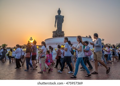 Nakonpatom,Thailand-February 22,2016 :  Thai Buddhism hold the fired candle in hand walking around Buddha statue on Makhabucha day at Phutthamonthol ,Thailand.