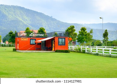 Nakonratchasrima, Thailand - August 2, 2017: Lucerne Villa Resort  ,Khaoyai Container villa  ,modern shiping container house  with deck ,green field and blue sky.