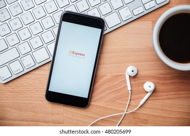 NAKORN PATHOM, THAILAND - MAR 3, 2016: Aliexpress app showing on iPhone 6 on the wooden desk. Aliexpress is one of popular e-commerce application launch in 2010