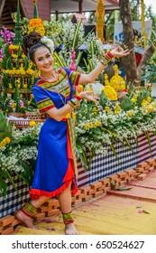 NAKORN PHANOM, THAILAND - FEBRUARY 14, 2015: Thai northeastern Phutai dancer with traditional costume in Phutai world event day in Renunakorn of Nakorn Phanom, Thailand.