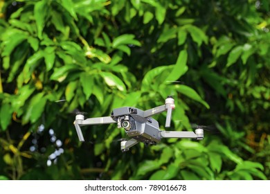 NAKORN PRATHOM THAILAND - 8 JANUARY 2018 - Unmanned aerial vehical with video camera hovers in the air. This is DJI Mavic Pro model.