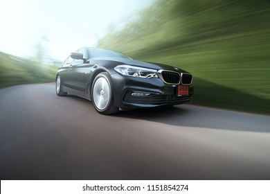Nakornnayok, Thailand - August 5, 2018: Test driving BMW 520d on the asphalt road in Nakornnayok, Thailand.