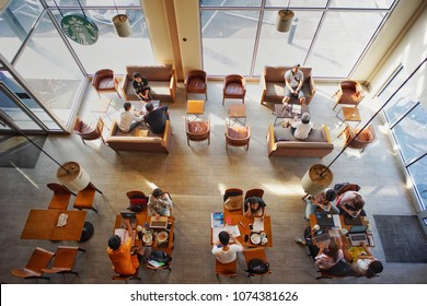 Nakornpratom, Thailand:April 22,2018- Top view of Starbucks coffee in the sunny day. Co-working space concept