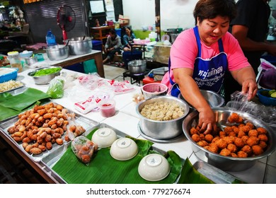 Nakornratchasima, THAILAND - 17 December 2017 : Local merchant at the morning market selling variety of foods at Phimai market in Phimai district , Nakornratchasima , Thailand.