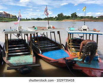Nakornsawan/Thailand - July 31, 2016: The boat driver is preparing the boat to wait for customers to use. Customers can be hired to cruise the river to see how the lives of people living on the water.